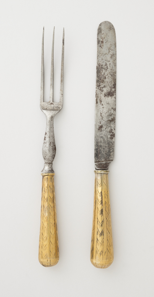 Fork has three long curved tines, rounded shoulder and flat baluster-shapedneck ending in a threaded projection.