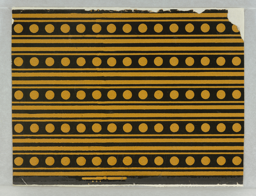 Five borders printed across width of paper. Wide black band containing row of mustard-yellow dots, with narrow black band above and below wide band. Printed on mustard-yellow ground.