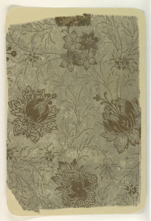 Aesthetic style design. Stylized floral motifs in metallic gold. Vines and tendrils are represented by a dotted pattern. Printed on a now-mottled gray background.