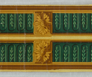Narrow border, printed two across, each a mirror image of the other. Cabled fluting, with acanthus boss at regular intervals.
