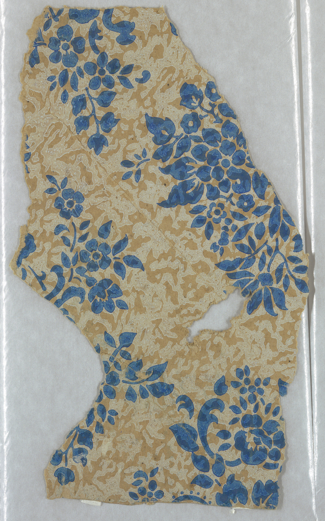 On an ungrounded paper is an all-over texture design in white with over-printed clusters of blue flowers and foliage. Both white and blue printed with diluted, transparent pigment.