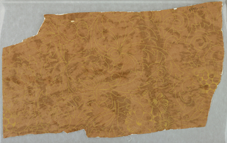 Fragment of irregular outline. All-over pattern of vine foliage set with conventionalized floral shapes, in slight outline.