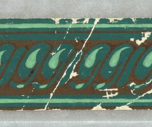 Fragment.  Green stripe on black.  H# 527