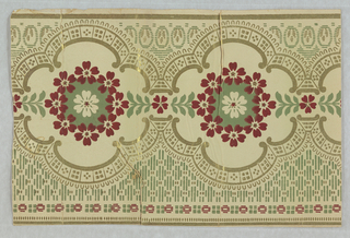 Center flower with surround of red flowers, with each circle enframed with gold scrolls and lace-like motif. Above band of this motif is a dot-dash pattern printed in dark green and gold, while below is a narrow band of gold egg-shapes containing gold dash motifs.