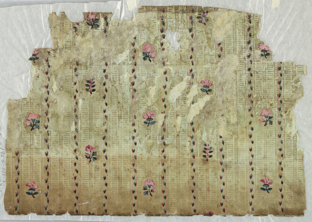 Double rows of pale green vertical ladder stripes bordered by columns of green and red sprigs. Along every other vertical double row is placed a widely spaced vertical series of small roses and other flowers. Irregular horizontal rectangle. Printed on neutral ground.