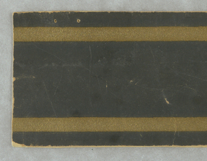 Black border with two gold lines.