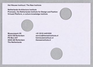 White mailing label with printed black text and three holes.