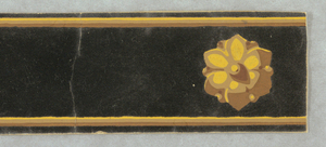 A simple band of rosettes with a flocked background. Printed in dark brown flocking, tan and yellow.  H# 1