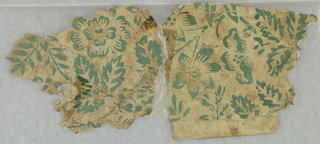 Floral and foliate design. Printed in green on off-white ground. Two pieces joined together with glassine.