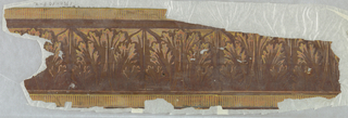 Acanthus leaf architectural border, printed in shades of brown, with bands of dentiling at top and bottom edges.