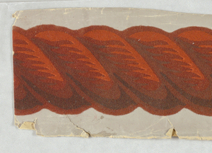One strand of a narrow rope twist or cable molding border. Red flock overprinted in shades of orange and red on white ground.  H#323