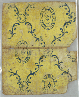 Lozenge framework formed of foliate scrolls, with small beaded circular motif at points of intersection, enclosing elliptical paterae. Formerly used as a book cover.