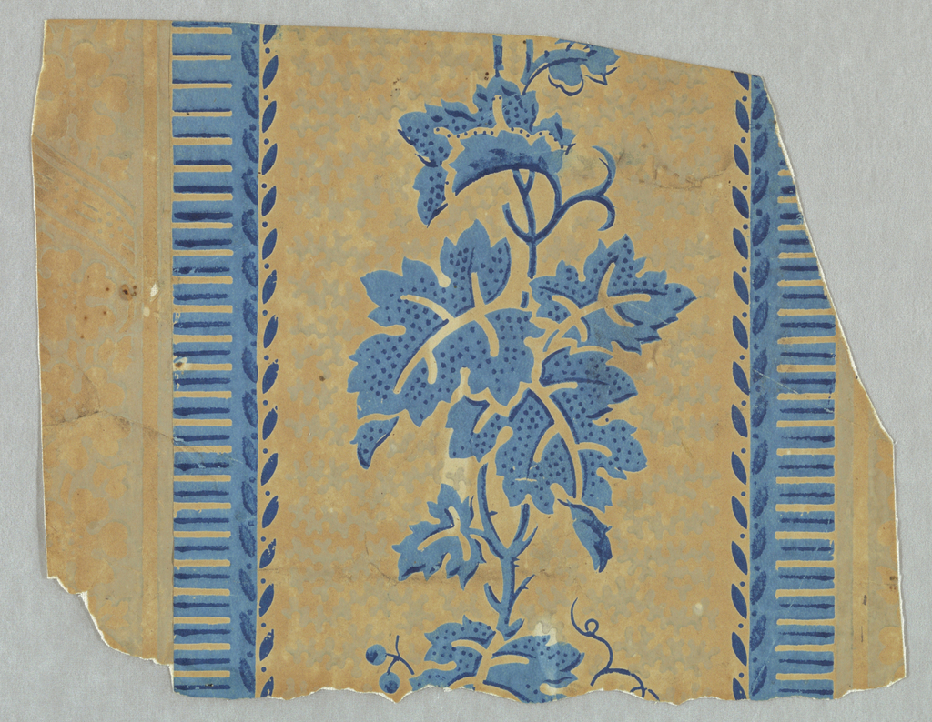 Portion of an axial vine arrangement between denticulated stripes edged with leaf forms. Ground pattern of vermiculation. Printed in blues and white on ungrounded paper.