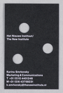 Black printed business card with white text and three holes.
