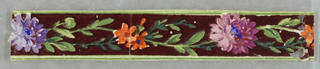 Fragment of machine printed.  Very narrow floral border on maroon ground.