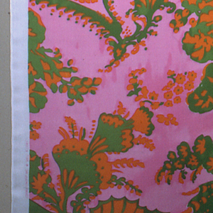 "Printed in green, pink and orange. Pattern shows large scale swirling ""bizarre"" design of wings and floral elements."