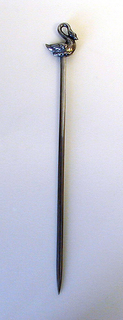 Pointed straight blade, the terminal formed as a cast swan with arched neck.