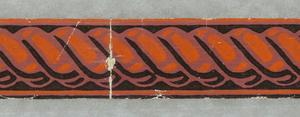 Border of twisted pattern in orange on dark ground.  H# 619