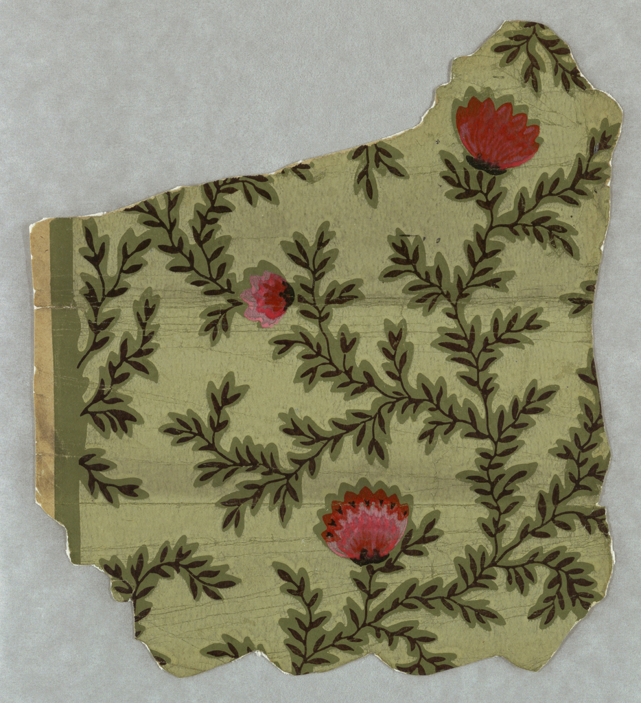All-over vine pattern with floral forms. Printed in pinks, black and green on green ground.