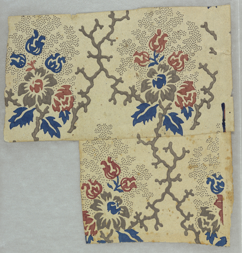 Floral bouquets with stippled, shaped ground, enclosed in irregular framework of coral-like branches. Printed in red, blue, and gray on rough grayish paper.