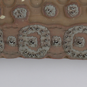 Square wood block for printing handkerchiefs. Set with design in metal of rosettes and arches.