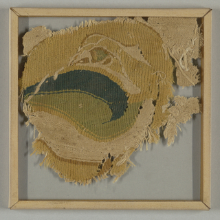 Roundel filled with a plump goose-like bird with back-turned head. In blue-green, yellow-green, tan, and golden yellow wools and natural linen. Remains of undyed linen cloth originally surrounding the roundel.