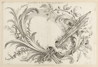 Arrangement of acanthus leaves, twigs, branches, and berries to frame a compartment resembling a painter's palette. A bundle of eight long paintbrushes extend from lower center to upper right.