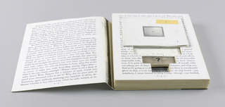 As a working copy, this object shows the development of the Chiat/Day self-promotion piece, Loomings. (See 1993-151-416.) Two pages of text, recto and verso of one sheet, are headed Chapter I, Loomings. Page three of the text is mounted on cardboard, which on the outside gives the appearance of actual pages, but is incised on the inside to hold three booklets, a fake chocolate bar and two pencils. (There is space for six pencils, but only two are included, as is an incised circle for a U.S. quarter, which is absent.) The top booklet, in black and white, has a cover image of a television screen, imprinted Hello in the center, and promotes the Chiat/Day agency. Below is a second booklet with a map design cover, imprinted Mojo?, and blank pages within. Below that is a spiral bound booklet with a tan cardboard cover imprinted with the agency's name at the top and who's who? in the lower part, containing white pages imprinted with promotional material about various watch products. On the bottom layer are the pencils, one of which is imprinted Ciat (sp.) Day Mojo and has a sticker imprinted Good Clients; and the fake chocolate bar, imprinted food for thought, centered in white on black.