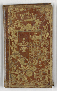 """Vertical rectangle. Brown leather binding, tooled in gold with coat-of-arms surmounted by a crown, with curvilinear decoration (on both front and back). End papers of """"Dutch gilt"""" with stylized flowers and fruit in brick red."""
