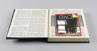 The case, exterior covered in black fabric, and labelled Distinctive on the spine in hand-pasted gold paper letters, is designed to simulate a book. There is one page within imprinted with text, recto and verso. Page three, continuing the text, is mounted on cardboard which on the outside gives the appearance of actual pages, but is incised on the inside to hold a booklet, a videocassette and case, and an audiocassette case. The booklet cover, composed of a nighttime street scene with electrified signs, is bordered in red, with the top right-hand corner in yellow turned down, imprinted Advertising and Nothing But, with a crowd of people behind. SPACE is imprinted in large type across the upper part; SONY is imprinted immediately below on the left, once horizontally and twice vertically, surrounding a white rectangular space. There are two additional blanks in white below the  Sony area and three smaller white blanks on the lower right.  The videocassette case reproduces a photograph of the upper part of a face, showing eyes, brows and a cut out inverted V shape simulating a nose. Chiat Day Mojo's Greated Hits- A tape that will forever prove that commercials are better than T.V. shows is imprinted across the top.  The audiocassette liner, recto, reproduces a partial profile view of a man's face, showing an ear and hair. Radio is imprinted on the left and What it would sound like if Chiat Day Mojo was the world's only agency on the right. On the verso is a cover design for an audiocassette, a Touch of Class, featuring the figure of a man in white tie and tails, with The Mighty Sparrow superimposed in shocking pink letters.