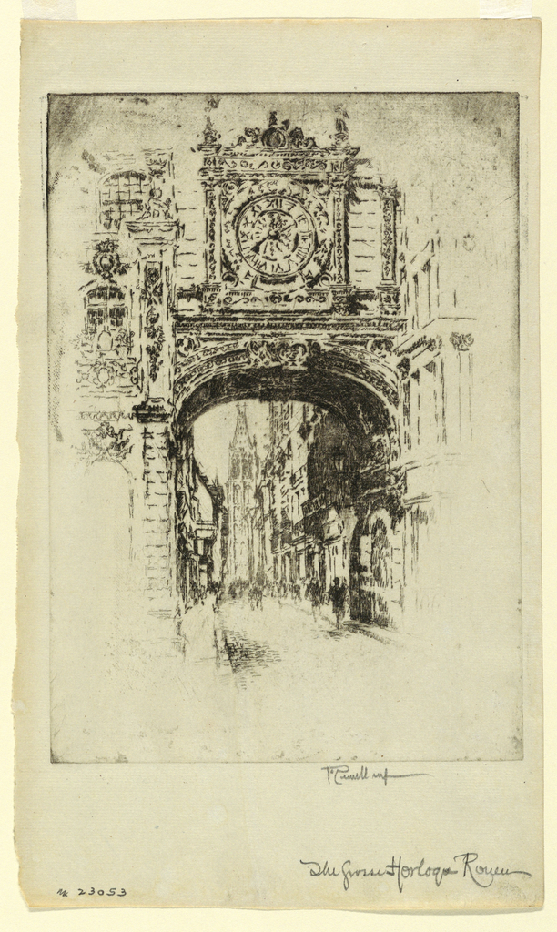 The archway with the great clock spans the street. In the far distance is a church tower.