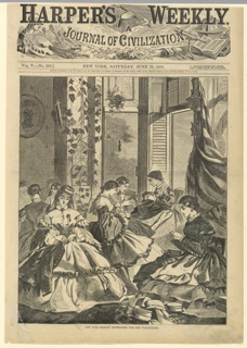 Vertical view of an interior with a group of women sewing in the foreground.