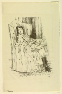 A woman sits in a large overstuffed chair, her legs crossed and a book in her lap.