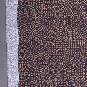 Oatmeal cotton printed with all-over geometrical pattern in dark gray and tan.