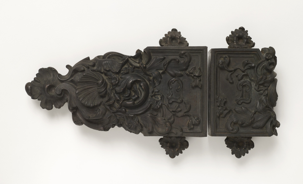Cast of a lock with its catch, decorated with foliage and flowers.  Keyholes, holes for screws and for bottle, unworked.  (in the style of about 1725)