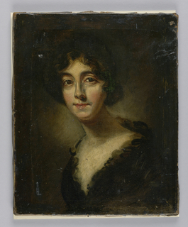 Bust length portrait of a young woman, body turned to observer's left, head facing front. The woman is unidentified.