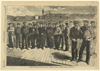 Horizontal group of sailors standing on the deck of the ship, facing the spectator.
