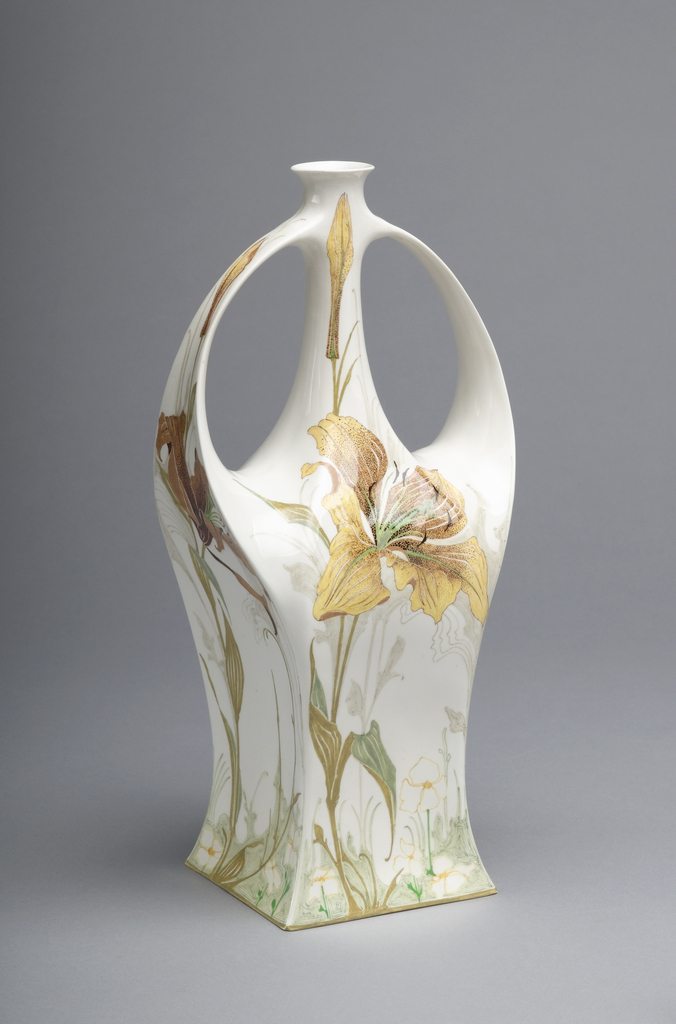 Four-sided base rising to curved wide handles that branch from shoulders and join narrow tubular neck under rim; painted decoration of lilies in orange/brown tones.