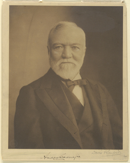 Bust length photographic portrait of Andrew Carnegie (1835-1919), turned slightly to the right. He wears a bow tie and coat with double lapels.