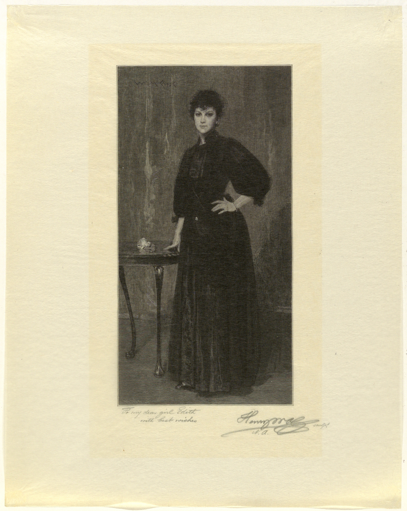 Full length portrait of a woman in black standing by a table, seen frontally. He right hand rests on the table, and her left is on her hip.