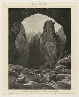 View of landscape from one side of narrow round opening in mountain. River running below and very tall cliffs in middle distance. Snowy peaks in background.