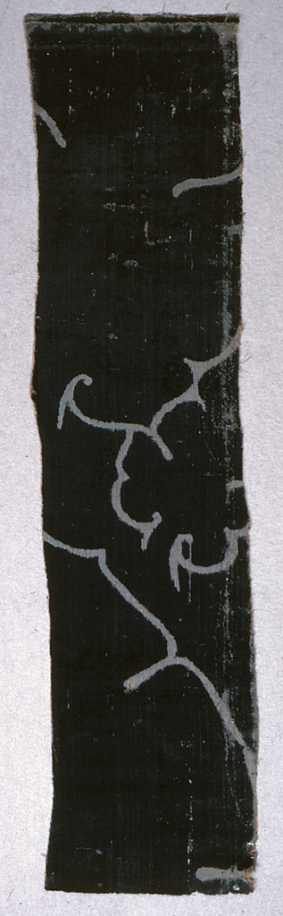 Small strip of dark blue voided velvet of the ferronerie type with portion of a much larger pattern.