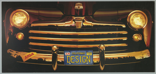 "Glossy poster with rendition of the front grill of a Ford car, circa 1950s.  The license plate reads, ""California Design."""