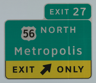 Sign in green with white text: EXIT 27 / 56 [interstate symbol] NORTH / Metropolis; and lower section in yellow with black text: EXIT [an arrow] ONLY.