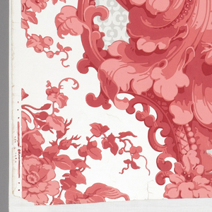 Rococo revival-style with very large foliage and scroll design with large cluster of roses as major motif. The match is dropped with join occurring at the center of the bouquet. Printed in pink and gray on a white satin ground.