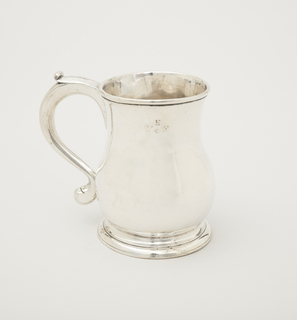 "Baluster-form mug with scroll handle. Engraved ""WEF"" with asterick under the E."