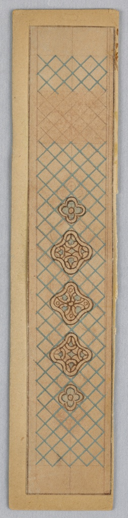 Vertical rectangle of yellow paper decorated with crosshatched pattern in blue and five 4-lobed floral medallions.