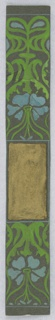 On dark gray ground, green vines and light blue flowers; rectangular gold painted cartouche.