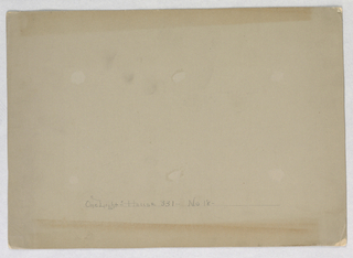 Blank beige illustration board with remnants of small areas of adhesive.  Ruled lines at bottom with title.