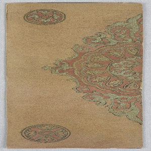 On brown-orange ground, medallion with arabesques, hearts, and C-curves in red, light green, and orange. Upper left and lower left smaller round floral medallions.